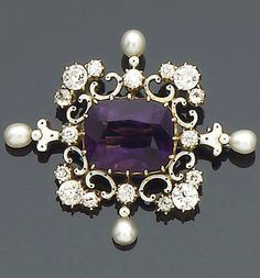 An Amethyst, Diamond, Seed Pearl, and Enamel Brooch, circa 1900 Claw-Set to the Center with a Cushion-Shaped Amethyst, Within a Scrolling Quatrefoil Border Decorated with Black and White Enamel, Old Brilliant and Single-Cut Diamonds and Four Seed Pearl Finials, Length 3.8 cm.