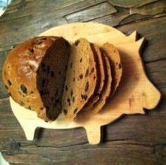 Have you ever tried Russian Black Bread? I grew up on it in New York City. Our local bakery's version was dark brown, filled with raisins, and didn't have caraway seeds, which was a relief, since I don't like them! There was something very special...