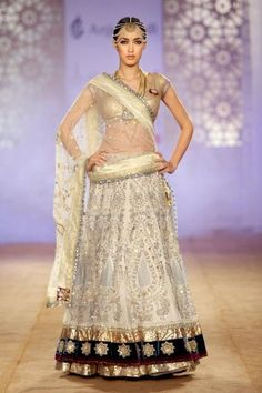 White and Gold lehenga by Anju Modi  for more visit www.stylettosbride.blogspot.com