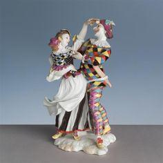 Plastik: tanzende Harlekinfamilie