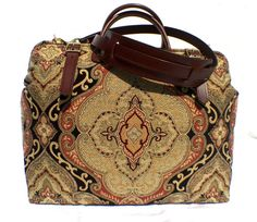 This Carpet Style Travel Bag is Ideal for Business or Pleasure use, whether Catching a Flight to New York or a Train to Paris for the Weekend, this Classically Designed Bag will get everything you need there in style!  Measuring 18 L x 8 W x 14H, this Timeless Classic Bag is Constructed using the Finest Leather and Upholstery Fabric and with Quality Brass Hardware, Steel Frame, Heavy Duty Sewing Thread, Copper Saddlers Rivets, and Five Brass Feet. It really will last you a lifetime!  Fully…