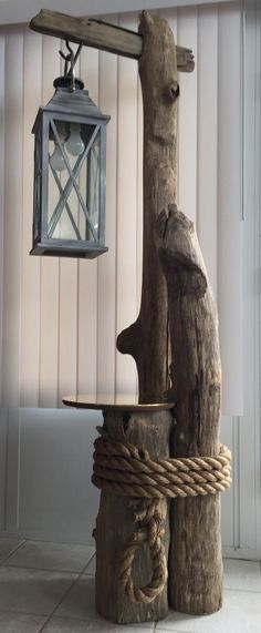 """Starting Woodworking Business Ohio River driftwood, converted lantern, brass table top, and massive rope all come together perfectly for this awesome """"nautical feel"""" floor lamp. Driftwood Flooring, Driftwood Art, Driftwood Table, Driftwood Furniture, Into The Woods, Rustic Outdoor, Outdoor Decor, Nautical Decor Outdoor, Nautical Deck Ideas"""