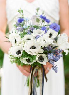 blue-white-spring-bridal-bouquet: tweedia, muscari, light and dark blue delphinium, bachelor buttons/cornflower, nigella, and thistle.