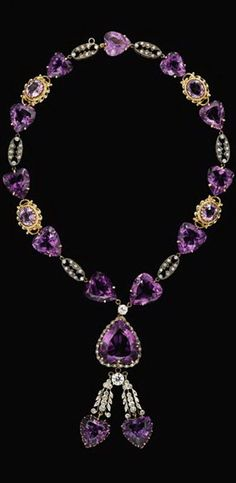 14 karat yellow gold, amethyst and diamond necklace Heart and oval cut amethyst stones with alternating links that are silver topped. Amethysts are accented by petite and rose cut diamonds, the necklace featuring a single 1 carat round cut diamond in the terminating tassle. Total amethyst weight is approximately 115 carats, total diamond weight is approximately 4 carats.