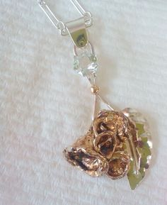 Hand made water casting and topaz pendant