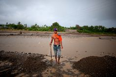Angelino from Dili on Timor-Leste makes his living by shifting sand into trucks for use in construction sites around Dili. He hopes to get all this shifted before the rains come and the river fills up.