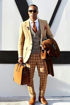 For me, this guy looks like he went into his closet with blinders on. Nothing matches. Nothing. Bad. This is what you DON'T do.