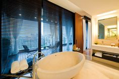 Exclusive Hotel Layout Interpreting Contemporary Flair: Fantastic Bathroom Inside Bulgary Hotel Milan With White Tub Dark Shutters Floating . Bulgari Hotel Milan, Bvlgari Hotel, Milan Hotel, Carron Baths, Bathroom Candles, Romantic Bathrooms, Luxury Bathrooms, Wooden Shutters, Voyage