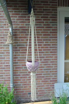 Macrame plant hanger. Interesting hanging part.