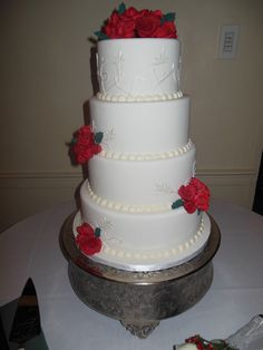 Simple 4 tier wedding cake with fondant roses