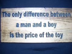 The only difference between a man and a boy is carved by SaShayIn, $15.00