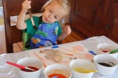 Kool-Aid Painting.  Makes scratch and sniff paintings!  Can also mix with whipped cream for finger paint.
