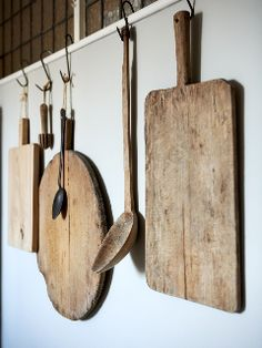 wood cutting boards hanging on hooks