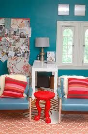 Image result for red chair with teal peacock wall colour