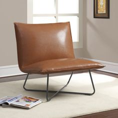 Constructed with a uniquely low seat and plush but firm cushioning, this saddle brown lounge chair is a comfortable and stylish addition to any home. Upholstered in sleek bonded leather and designed w