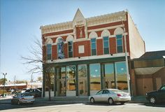 Grand Army of the Republic Hall---Grand Island, Nebraska. Cornerstone of the G.A.R. Hall was laid in 1886, From 1893 to 1910 the Post Office had a ground floor space in this two story brick building. The building still stands, and most of the original architecture remains.