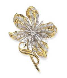 A GOLD AND DIAMOND BROOCH Designed as a polished gold flower, accented by circular-cut diamonds, centering upon a circular-cut diamond pistil, extending a marquise-cut diamond spray