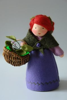 Herbwoman - Flower Child - Waldorf Inspired - Nature Table   The dollis made of 100 % wool-felt, fairy tale-wool and tricot material. The doll is approx. 19 centimeters high The filling is sheepwool