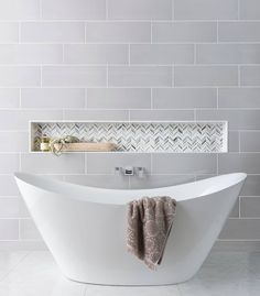 """We like to think of shower niches as beautiful + functional pieces of art. With endless customization options, it's an easy way to bring a little """"you"""" into your space.  Tiles featured: Marta Gris 8x24in., Alato Beachwalk Chevron, Carrara Gris 12x24in., + Meram Blanc Somerset. Bathroom Niche, Bathroom Trends, Bathroom Colors, Bathroom Sets, Modern Bathroom, Small Bathrooms, Bathroom Recessed Shelves, Bathroom Wall Tiles, Bathroom Island"""