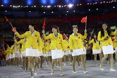 When stood next to the  females' loud yellow jackets, the Chinese team looked like a plate of scrambled eggs covered in sauce