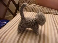 Simple knitted kitten. Just need to knit 3 rectangles (basically) and sew them together and stuff them. Super easy! First thing I ever knitted. My child loved the kitty and dragged it around on a string leash!