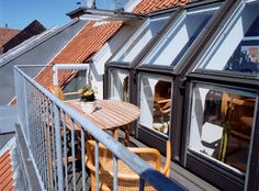 VELUX roof terraces. Imagine a lazy Sunday brunch or romantic evening meal sitting on your own roof terrace!