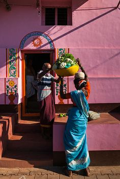She that brings the basket/horn of abundance and Old man receiving the invitation ,The Door of OM/Aum,India