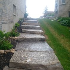 Steps installed to the side of a house by Platinum Stone Design
