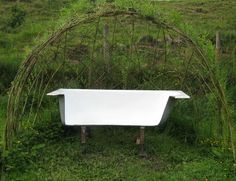 Garden bench made from old bathtub
