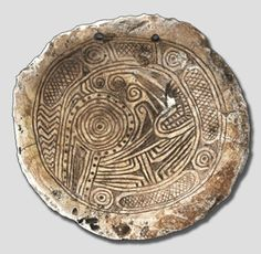 A Mississippian culture Citico style herpetomorphic themed shell gorget found in Anderson County, Tennessee.