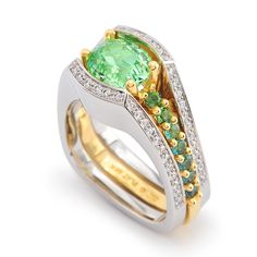 2.04ct Mint Tsavorite Garnet accented with Round Brilliant Cut Diamond and Tourmaline set in 18k Yellow Gold and Platinum.