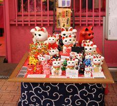 "Maneki Neko Lucky Cat Meanings   The thousands of ""beckoning"" cat residents of Japan's Gotoku-ji Temple ..."