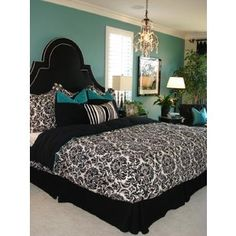 I'm going for something similar in master bedroom. Black and white with teal accents, maybe a pop of lime!