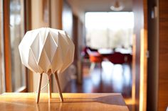 Here's the story behind this origami shade lamp that's designed to fit into a shipping tube and require no hardware to assemble