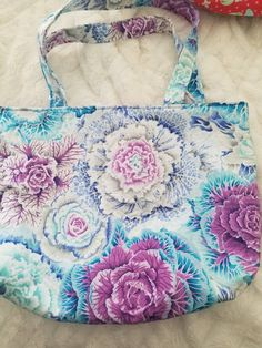 Multi colored flower tote bag, handmade with purple lining Floral Tote Bags, Handmade Items, Handmade Gifts, Blue Flowers, Craft Supplies, My Etsy Shop, Reusable Tote Bags, Unique Jewelry, Purple