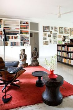 The New Living Room: 4 Top Trends Floor is the focal point. The red rug somehow grounds this all white  living room.