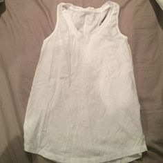 Basic white tank Worn once. XS, not fitted. V neck line Merona Tops Tank Tops