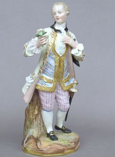 Meissen Model: A 58        Description: Man with Flower Bouquet   Modeled By: Michel Victor Acier ca. 1764   Mark: A 58       Painter Number:    Height: 8 in - 20.3 cm