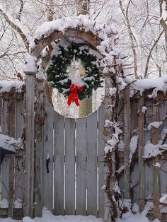 Snow dusted arbor and wreath in the courtyard. Iowa A Winter Garden. Noel Christmas, Country Christmas, All Things Christmas, Winter Christmas, Christmas Wreaths, Christmas Decorations, Christmas Garden, Hirsch Illustration, Theme Noel