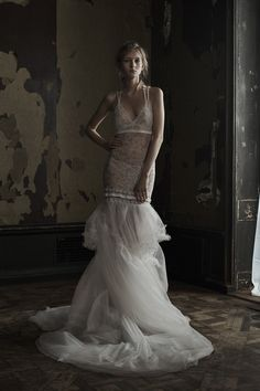 Vera Wang Spring 2016 Bridal - Light ivory V-neck hand applique Chantilly lace mermaid gown with pleated ribbon and silk flower details accented by tumbled hand pleated tulle skirt and plunging back with silk flower embroidered straps. Styled with Chantilly lace bra and panty with silk flower applique on the bra.