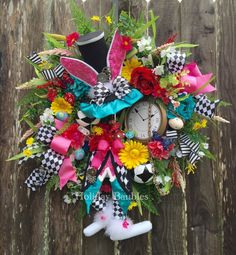 A personal favorite from my Etsy shop https://www.etsy.com/listing/271620703/mad-hatter-mad-hatter-wreath-alice-in
