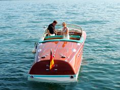 """Classic Riva on Lake Garda ~ """"HERMES"""" The Last Tritone .. the aquamarine accents on this boat almost completely blend into the water color in this picture."""