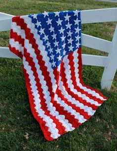Patriotic crochet afghan. It's a beautiful piece, but it is a flag, so it should not be touching the ground :(