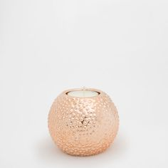 Image of the product COPPER-COLOURED CERAMIC TEALIGHT HOLDER WITH A RAISED DESIGN