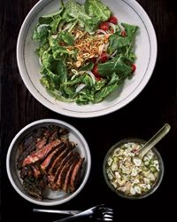 Baby Kale and Steak Salad with cucumber, tomatoes, and Vietnamese inspired nuoc cham dressing.