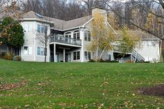 Multiple decks and the backyard of a home in Central New York