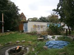 Fire area, and storage containers and the start of a new gardening area.