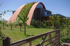 timbrel vaulting by Ecolibrium Solutions (Kent) the first (?) UK company to do this type of vault, could work really well for a hobbit hole.  This building while not hobbitty is totally gorgeous.