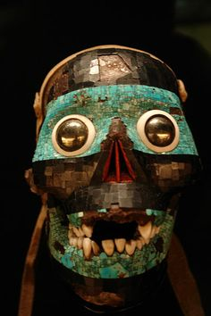 Turquoise mask representing the god Tezcatlipoca (one of the Aztec creator gods). The base for this mask is a human skull. Mixtec-Aztec. 1400-1521.
