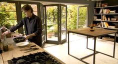 In love with this kitchen in Nigel Slater's TV show. Bi-fold door. Charcoal walls. White ceilings with medium white simple beams. Industrial but wholesome.